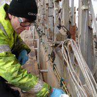 Man inspecting pipework