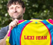 Man holding up Lexi Jean t-shirt