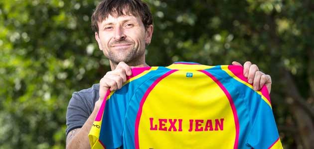 Man holding up Lexi Jean t-shirt